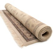 A rolled up area rug.