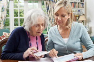 A senior woman discussing her finances with her daughter.