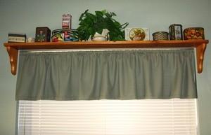 A space saving display shelf over a window.