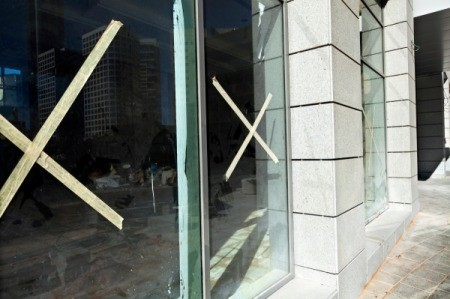 """Windows with a masking tape """"x"""" in the center, for protection."""