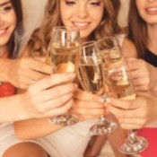 Woman toasting the bride at a bachelorette party.