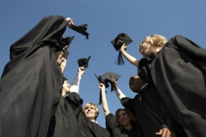 A group of graduates in cap and gown.