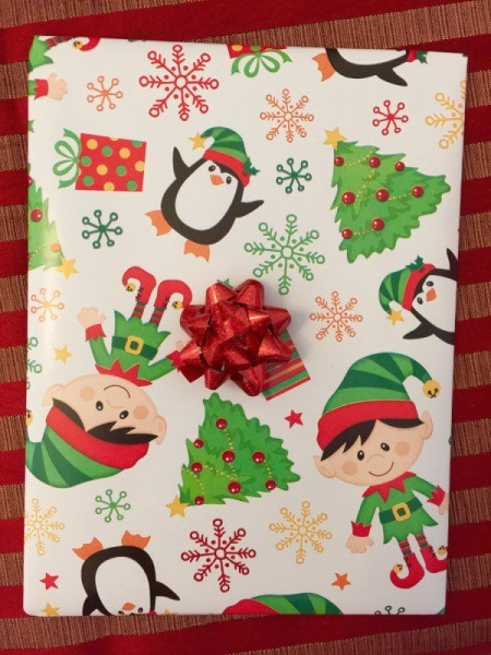 Finished present with a bow in the center.