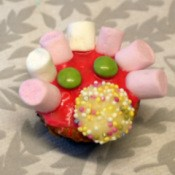 A decorated cupcake at a party.