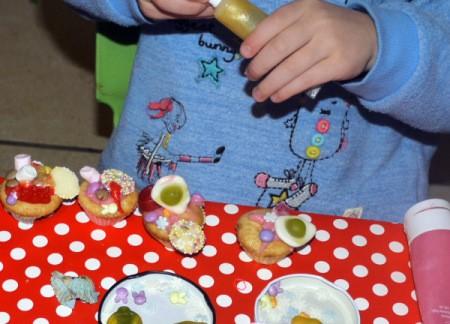 Decorating cupcakes.