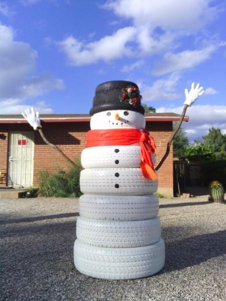 large tire snowman in desert yard