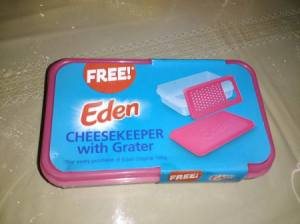 An Eden cheesekeeper and grater that came free with purchase.