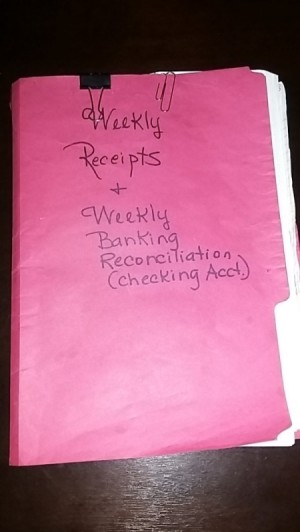 Bank paperwork held in a folder.