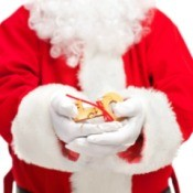 Santa holding a large magic key.