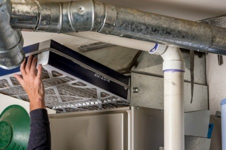 Changing a furnace filter.