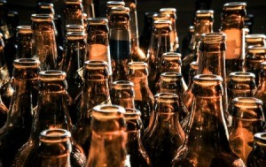 A row of empty beer bottles.
