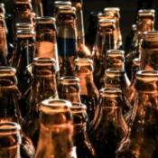 A row of empty beer bottles.
