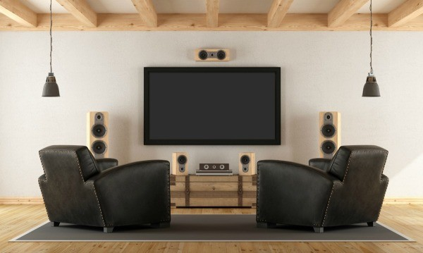 Two Black Armchairs Facing A Screen And Speakers
