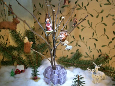 A small tree with Christmas figurines.