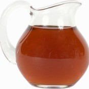 A glass pitcher full of tea.