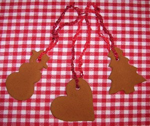 Three ornaments made from cinnamon and applesauce.