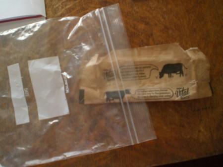 Placing a butter wrapper inside a ziptop bag.