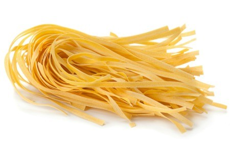 A serving of dried egg noodles, ready to be cooked.
