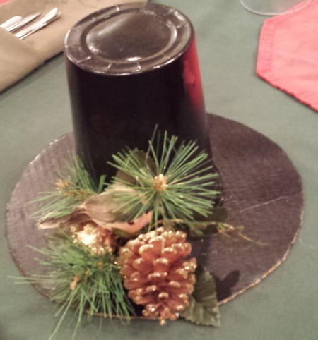 topcoat decoration with pine cone and yellow bird on evergreen branch