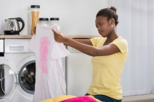 A pink stain on a tshirt discovered when doing laundry.