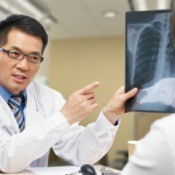 A doctor discussing a chest x-ray with a patient.