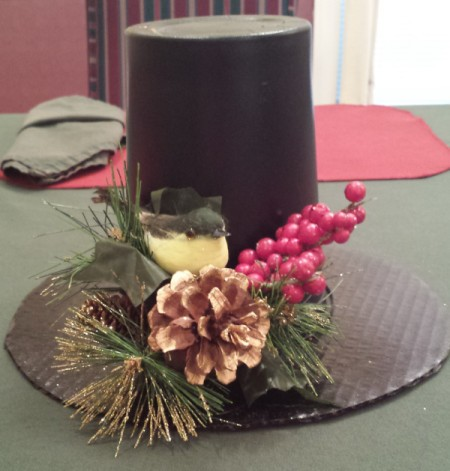 same decoration with the addition of a sprig of faux red berries