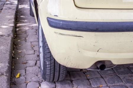 Black scuff marks on a car's bumper.