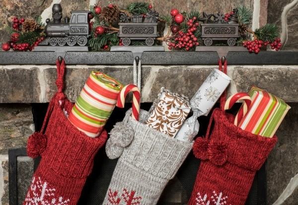 stockings hung on a fireplace mantle finding the perfect yet inexpensive stocking stuffers