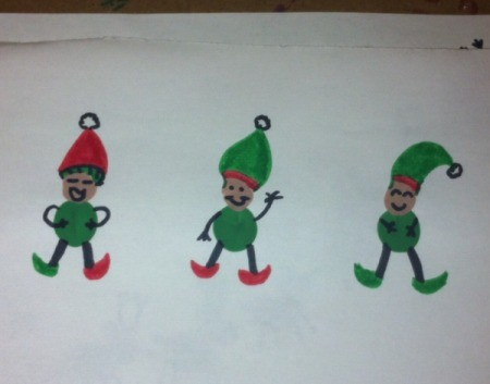 three fingerprint elves on white paper