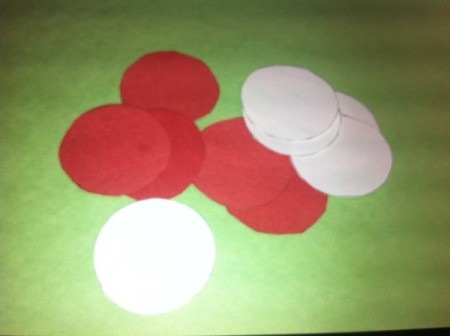 cut out red and white paper circles