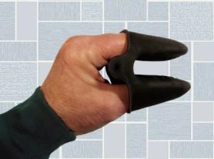A silicone kitchen mitt on a hand.