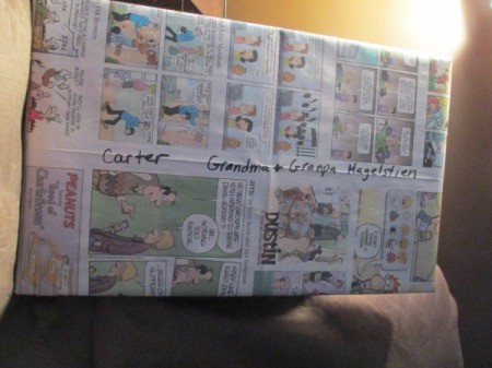 A present wrapped in comics from the paper.