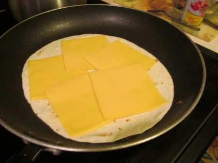 tortilla with cheese in pan