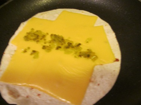 tortilla cheese & pickle relish in pan