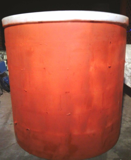cylinder covered in red paint