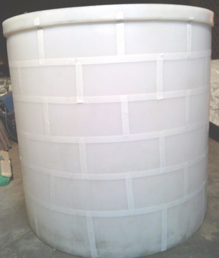 cylinder with all of the tape applied to mark bricks
