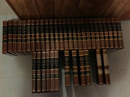 set of encyclopedias standing on the floor