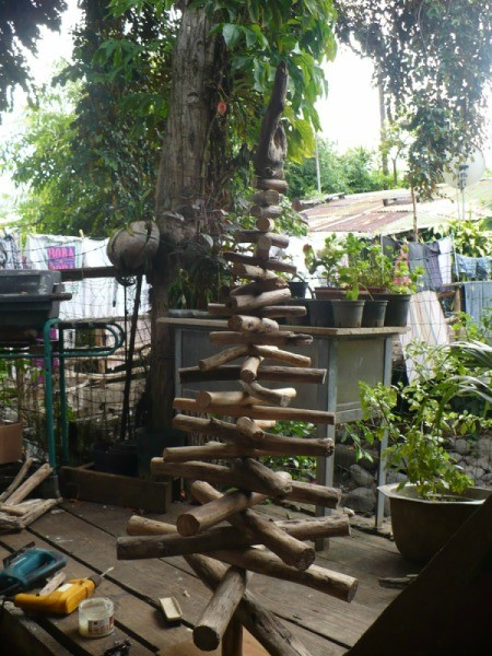 Driftwood Christmas Tree - finished tree and tools on a wooden deck