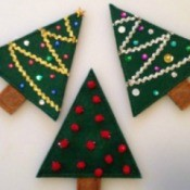 Three Christmas tree treat holders made from felt.