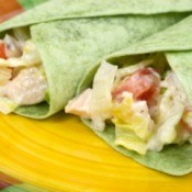 Two sandwich wraps using spinach tortillas.