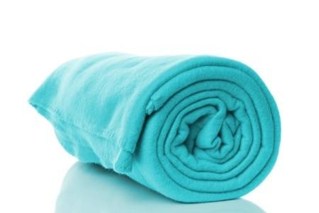 A green-blue fleece blanket.