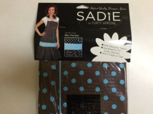chocolate brown apron with blue dots in package