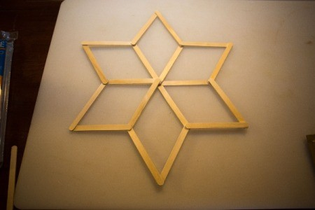Popsicle sticks in the shape of a six pointed star.