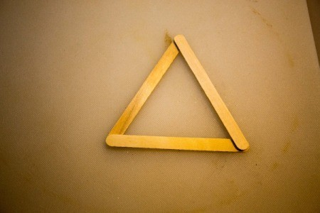 A triangle made from popsicle sticks.
