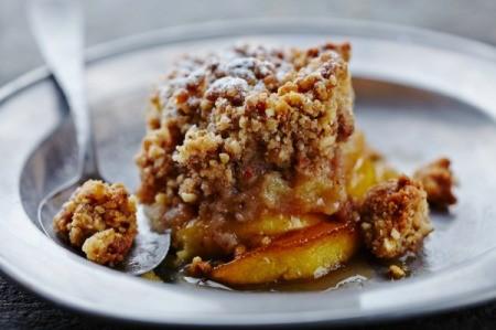 A serving of apple crisp on a plate.