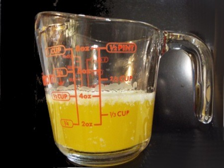 Melted butter in a measuring cup.