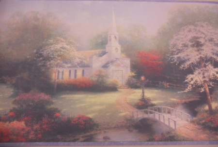 Thomas Kinked Wallpaper. A white church surrounded by trees.