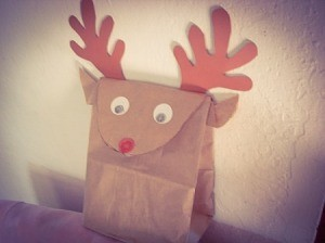 Reindeer bag sitting on the back of a chair or couch.