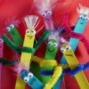 A bunch of puppets made from popsicle sticks.