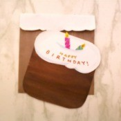 A birthday card shaped like a birthday cake.